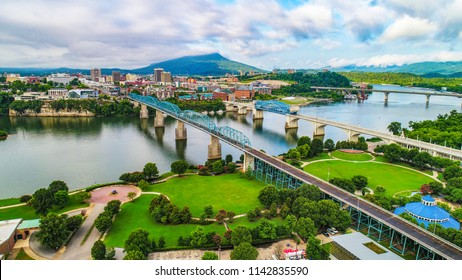 Drone Aerial of Downtown Chattanooga TN Skyline, Coolidge Park and Market Street Bridge.