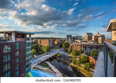 Drone aerial of the downtown Greenville South Carolina SC skyline at sunrise.