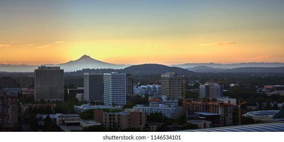 Drone aerial panorama at sunrise of Mt Hood and downtown Portland showing the a beautiful juxtaposition between nature and civilization