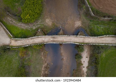 Drone aerial top above view of an ancient historic stone bridge in Idanha a velha, Portugal