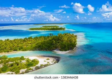 Drone aerial video of Rangiroa atoll island motu and coral reef in French Polynesia, Tahiti. Amazing nature landscape with blue lagoon and Pacific Ocean. Tropical travel paradise in Tuamotus Islands.