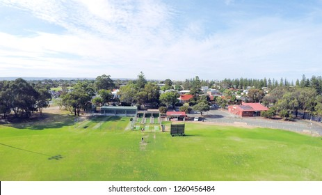Drone aerial view of Australian public park and sports oval field, taken at Henley Beach.