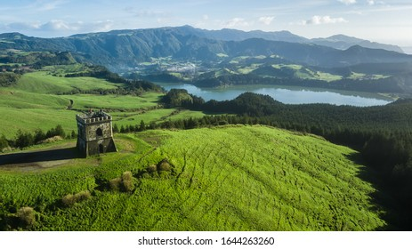 """Drone aerial view of """"Castelo Branco"""" historic monument with """"Furnas"""" lagoon on background in Sao Miguel island, Azores, Portugal."""