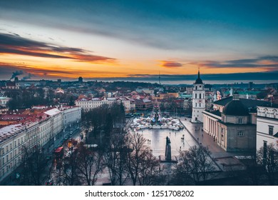Drone aerial view of Christmas Tree 2018 in Vilnius Cathedral square, Lithuania. Winter sunset.
