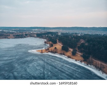 Drone aerial view of frozen lake in Kaunas, Lithuania