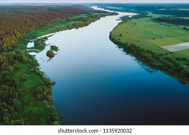 Drone aerial view of Nemunas river, a major Eastern European river. It rises in Belarus and flows through Lithuania before draining into the Curonian Lagoon, and then into the Baltic Sea at Klaipeda