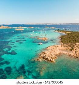 Drone aerial view of Razzoli, Santa Maria and Budelli islands in Maddalena Archipelago, Sardinia, Italy. Maddalena Archipelago is a group of islands between Corsica and north-eastern Sardinia.