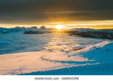 Drone aerial view of snowy mountains in Kronplatz, Italy. It is a mountain of the Dolomites in South Tyrol, with a summit elevation of 2,275 metres (7,464 ft) above sea level
