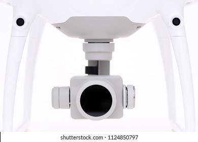 Drone camera close-up on white background. Front view of drone aircraft camera
