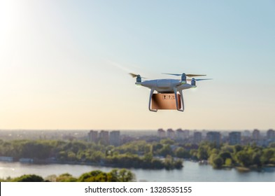 Drone carrying delivering package , city in background