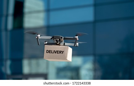Drone carrying delivery box. Fast and mass transportation concept, new technologies, quarantine delivery, copy space
