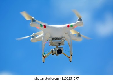Drone copter with digital camera;photographed on a defocused background.No logos in the photo.