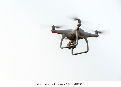 drone copter flying with digital camera in sky