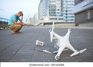 Drone crash. Fallen damaged quadrocopter in city