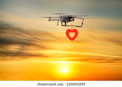 Drone delivering heart shape at sunset