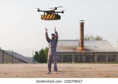 drone delivery to distribution factory where operator awaits