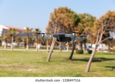 A drone with digital camera flying in the park