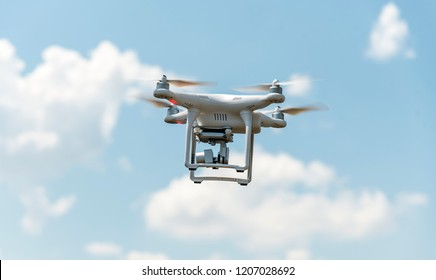 Drone with digital camera flying in the sky. Modern technology for aerial video and photography.