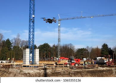 The drone flies over the construction site