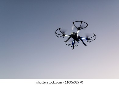drone in flight, quadrocopter
