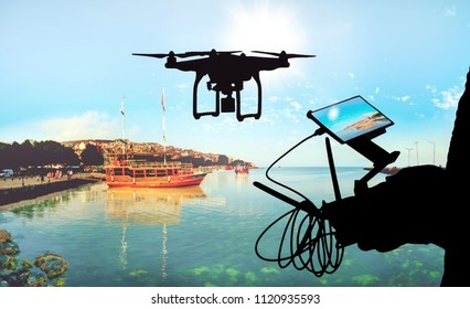 Drone flight remote controller in man hands. silhouette against the sky