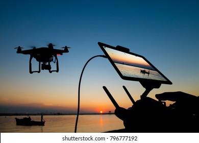 Drone flight remote controller in man hands