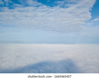 Drone flying above the clouds