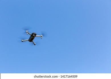 A drone flying against the blue sky