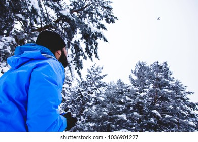 Drone flying during trekking in the snow