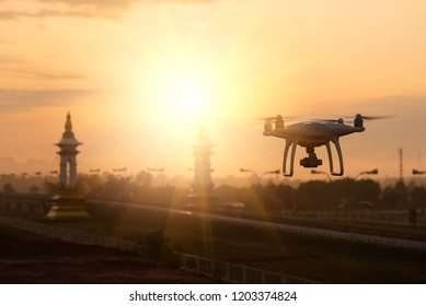 Drone flying on a mountain view at beautiful Sun light. Bridge background and copy space.