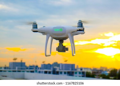 Drone flying on sunset sky in city building, Innovation photography