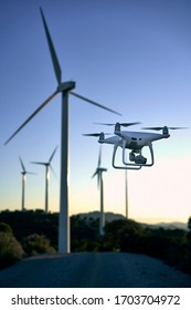 Drone flying over a background of wind turbines. Drone during maintenance and inspection of an aerial view of the wind turbine Inspection of wind turbines. concept, alternative energy sources.