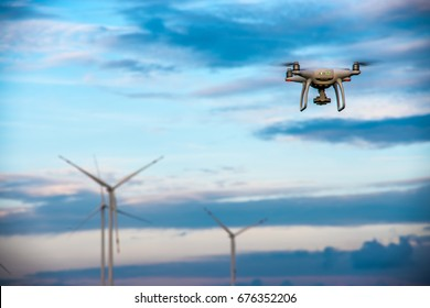 drone flying over the blue sky background to take a wind turbine photo  /  drone flying on the sky and the wind turbine