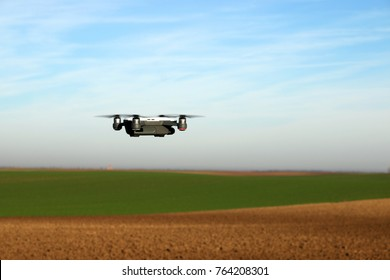 The drone is flying over the field
