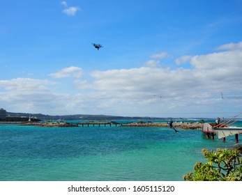 A drone flying over the ocean of okinawa