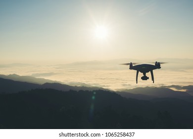 Drone flying in the sunset take a photo and video record