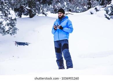 Drone flying view on low altitude during trekking in the snow