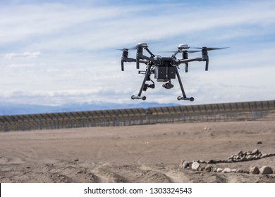 Drone flying and working for ortophoto and thermal analysis of PV Plants with visual and thermal camera. UAV are used for easy aerial inspections of Solar, Wind and Hydro renewable energy resources