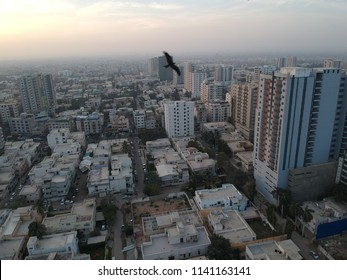 drone footage of day time karachi, crow,sky,buldings ,clouds and the streets of karachi