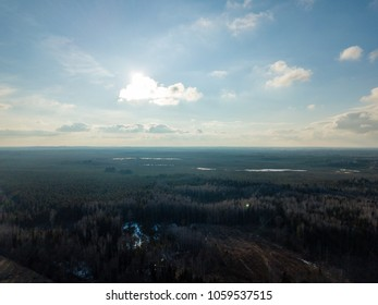 drone image. aerial view of rural area with fields and forest details in cloudy spring day. latvia