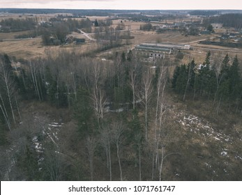 drone image. aerial view of rural area with fields and forest details in cloudy spring day. latvia - vintage look