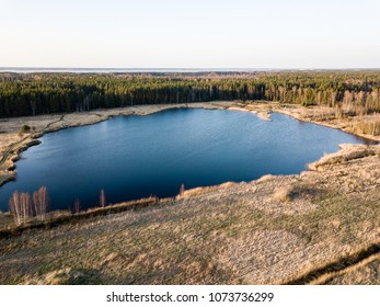 drone image. aerial view of rural area with swamps, lakes and forests in sunny spring day. Latvia