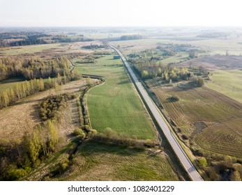 drone image. aerial view of rural area with gravel road network cloudy spring day. latvia