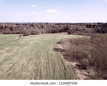 drone image. aerial view of rural area with fields and forests in sunny spring day. latvia - vintage film look