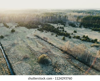 drone image. aerial view of rural area with swamps, lakes and forests in sunny spring day. Latvia - vintage look