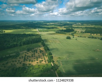 drone image. aerial view of rural area with fields and forests in cloudy spring day. latvia - vintage retro look