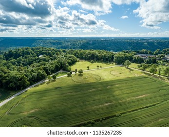 drone image. aerial view of rural area with green cultivated fields in summer day, shadows from clouds