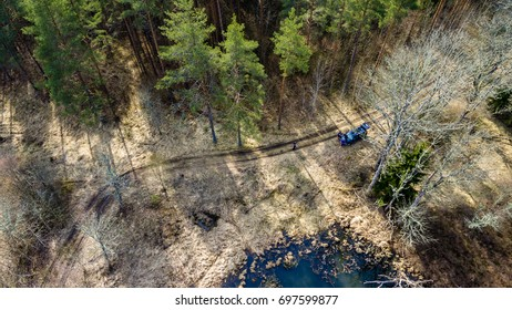 drone image. aerial view of rural area with forest lake in bright sunlight - panoramic image