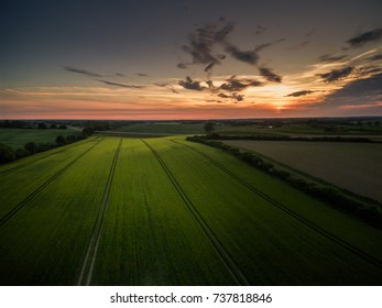 Drone image of farm fields in sunset