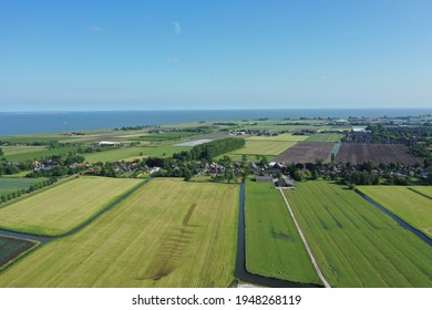Drone image of green lawns and farmland in the spring